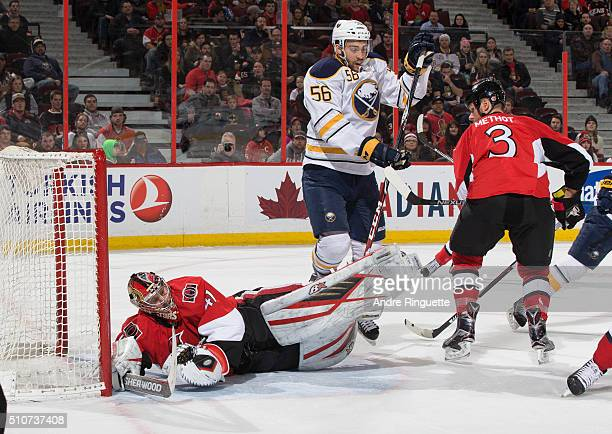 Justin Bailey of the Buffalo Sabres jumps to avoid a collision after a save by Craig Anderson of the Ottawa Senators at Canadian Tire Centre on...