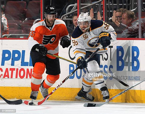 Justin Bailey of the Buffalo Sabres, making his NHL debut, skates the puck against Nick Schultz of the Philadelphia Flyers on February 11, 2016 at...