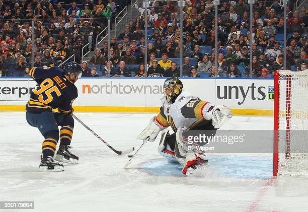 Justin Bailey of the Buffalo Sabres scores a third period goal against MarcAndre Fleury of the Vegas Golden Knights during an NHL game on March 10...