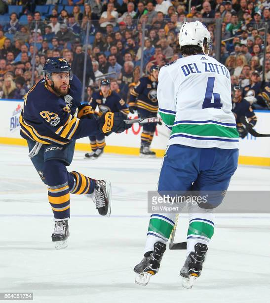 Justin Bailey of the Buffalo Sabres shoots the puck while defended by Michael Del Zotto of the Vancouver Canucks during an NHL game on October 20,...