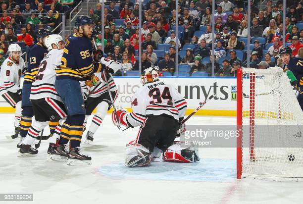 Justin Bailey of the Buffalo Sabres watches a goal by Nicholas Baptiste against JF Berube of the Chicago Blackhawks during an NHL game on March 17...