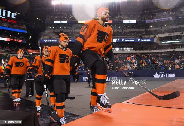 Justin Bailey of the Philadelphia Flyers and his teammates walk to the ice surface for warmup prior to the 2019 Coors Light NHL Stadium Series game...