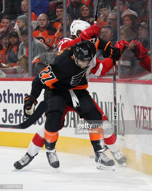 Justin Bailey of the Philadelphia Flyers collides into the boards with Mike Green of the Detroit Red Wings on February 16, 2019 at the Wells Fargo...
