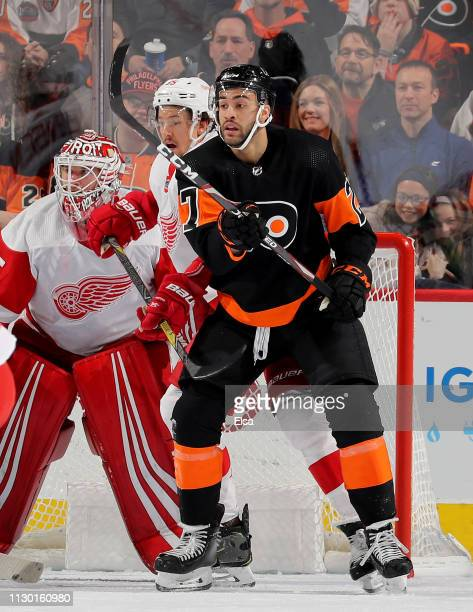 Justin Bailey of the Philadelphia Flyers fights for a spot in front of the net as Jimmy Howard of the Detroit Red Wings defends at Wells Fargo Center...