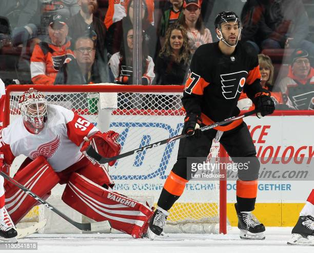 Justin Bailey of the Philadelphia Flyers sets atop the crease against Jimmy Howard of the Detroit Red Wings on February 16, 2019 at the Wells Fargo...