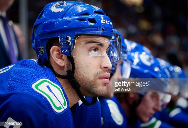 Justin Bailey of the Vancouver Canucks looks on from the bench during their NHL game against the Chicago Blackhawks at Rogers Arena February 12, 2020...