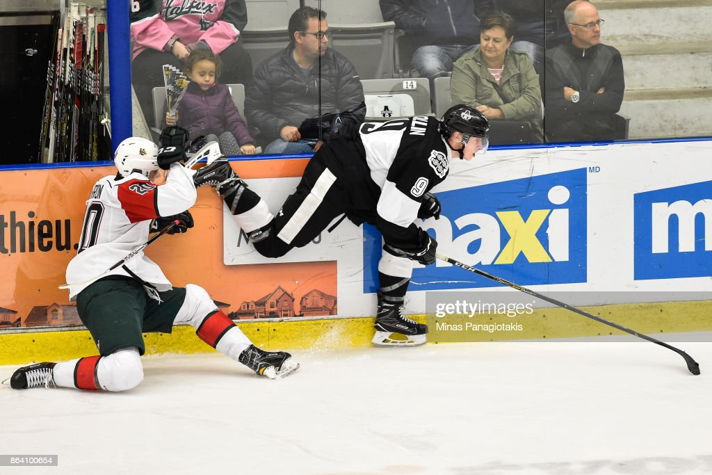 Justin Barron #20 of the Halifax Mooseheads falls as he protects his face from the skate of Maxime Collin #9 of the Blainville-Boisbriand Armada during the QMJHL game at Centre d'Excellence Sports Rousseau on October 20, 2017 in Boisbriand, Quebec, Canada. The Halifax Mooseheads defeated the Blainville-Boisbriand Armada 4-2.