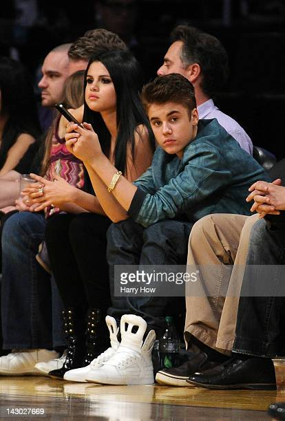 Justin Beiber and girlfriend Selena Gomez watch the game between the San Antonio Spurs and the Los Angeles Lakers at Staples Center on April 17 2012...