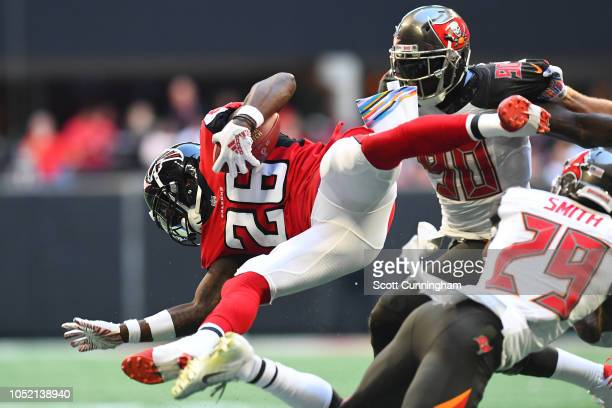 Justin Bethel of the Atlanta Falcons dives is upended during the third quarter against the Tampa Bay Buccaneers at MercedesBenz Stadium on October 14...