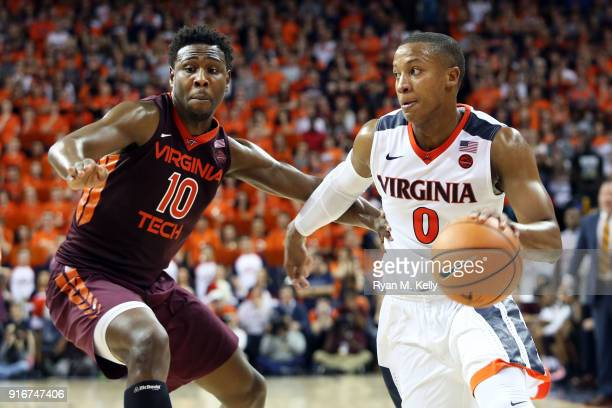 Justin Bibbs of the Virginia Tech Hokies defends Devon Hall of the Virginia Cavaliers in the second half during a game at John Paul Jones Arena on...