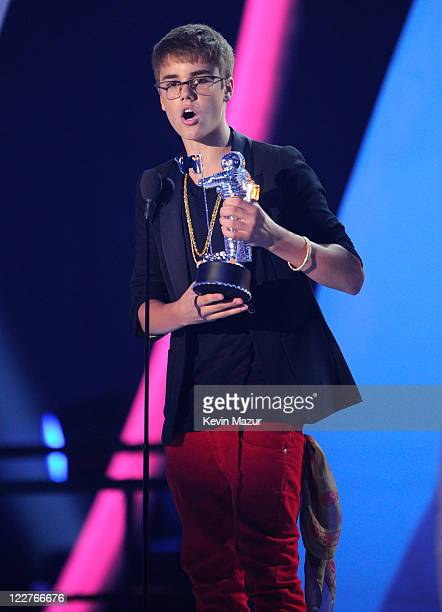 Justin Bieber accepts award on stage at the The 28th Annual MTV Video Music Awards at Nokia Theatre LA LIVE on August 28 2011 in Los Angeles...
