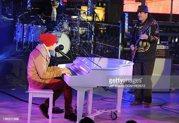 Justin Bieber and Carlos Santana perform during Dick Clark's New Year's Rockin' Eve with Ryan Seacrest 2012 at Times Square on December 31 2011 in...
