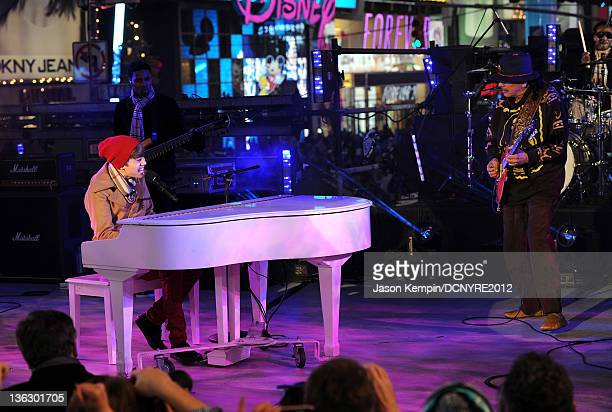 Justin Bieber and Carlos Santana perform onstage during Dick Clark's New Year's Rockin' Eve with Ryan Seacrest 2012 at Times Square on December 31,...
