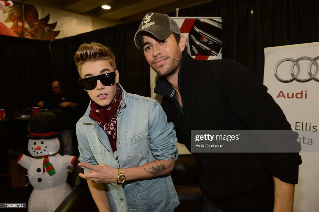 Justin Bieber and Enrique Iglesias pose backstage at Power 96.1's Jingle Ball 2012 at the Philips Arena on December 12, 2012 in Atlanta.