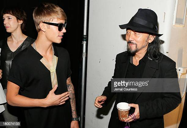 Justin bieber showcase pictures and photos getty images justin bieber and fashion designer yohji yamamoto meet backstage at the y3 springsummer 2014 m4hsunfo