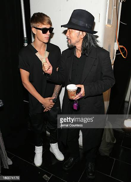 Justin Bieber and fashion designer Yohji Yamamoto meet backstage at the Y3 Spring/Summer 2014 show during MercedesBenz Fashion Week on September 8...