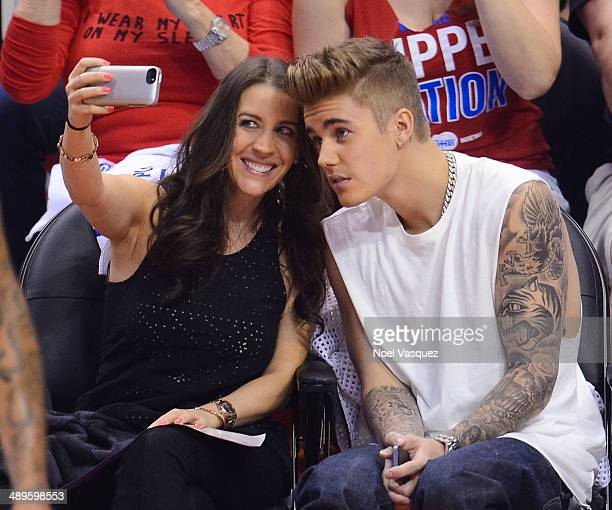 Justin Bieber and his mom Pattie Mallette attend an NBA playoff game between the Oklahoma City Thunder and the Los Angeles Clippers at Staples Center...