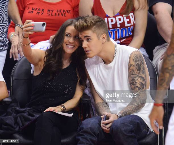 Justin Bieber and his mom Pattie Mallette take a selfie at an NBA playoff game between the Oklahoma City Thunder and the Los Angeles Clippers at...