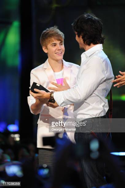 Justin Bieber and Ian Somerhalder on stage at the 22nd Annual MuchMusic Video Awards at the MuchMusic HQ on June 19 2011 in Toronto Canada