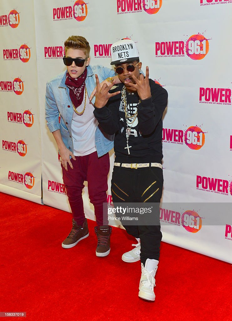 Justin Bieber and Lil Twist attend Power 96.1's Jingle Ball 2012 at Phillips Arena on December 12, 2012 in Atlanta, Georgia.