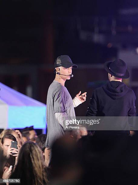 Justin Bieber and manager Scooter Braun confer when he performs on NBC's 'Today' Show at Rockefeller Plaza on September 10 2015 in New York City