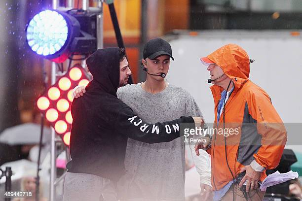 Justin Bieber and manager Scooter Braun confer with a producer when he performs on NBC's 'Today' Show at Rockefeller Plaza on September 10 2015 in...