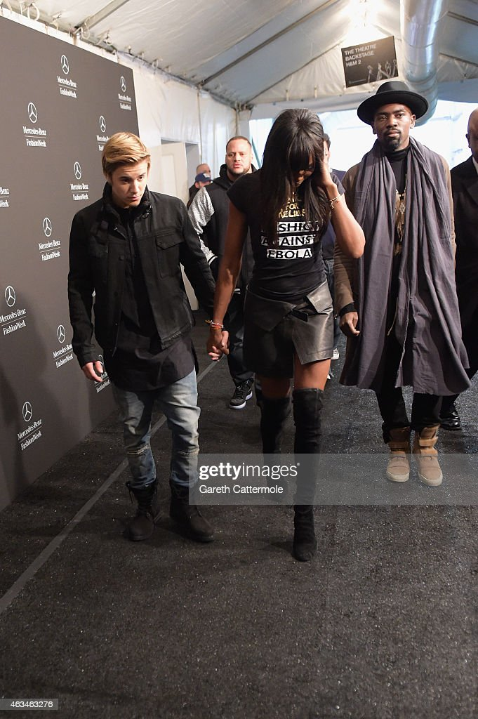 Justin Bieber and Naomi Campbell hold hands backstage at Naomi Campbell's Fashion For Relief Charity Fashion Show during Mercedes-Benz Fashion Week Fall 2015 at The Theatre at Lincoln Center on February 14, 2015 in New York City.