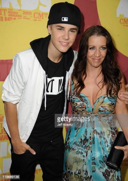 Justin Bieber and Pattie Mallette attend the 2011 CMT Music Awards at the Bridgestone Arena on June 8 2011 in Nashville Tennessee