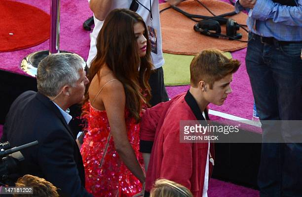 Justin Bieber and Selena Gomez arrive for the premiere of Katy Perry Part Of Me at Grauman's Chinese Theatre in Hollywood California June 26 2012 AFP...