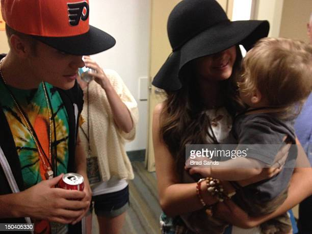 Justin Bieber and Selena Gomez relax backstage at a Phish concert on August 15 2012 in Long Beach California Photo by Brad Sands/FilmMagic