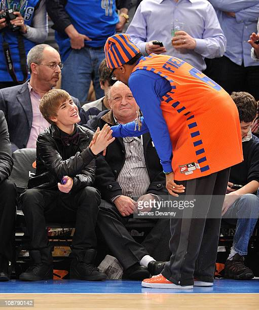 Justin Bieber and Spike Lee attend the Dallas Mavericks vs New York Knicks game at Madison Square Garden on February 2 2011 in New York City