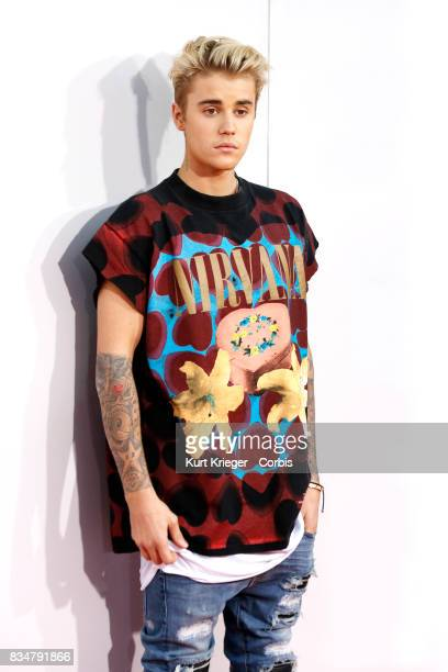 Image has been digitally retouched Justin Bieber arrives at the American Music Awards 2015 in Los Angeles California on November 22 2015