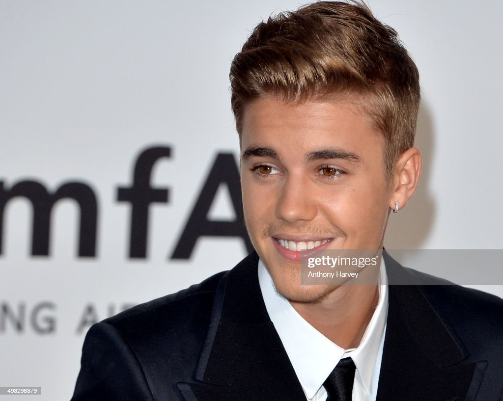 Justin Bieber attends amfAR's 21st Cinema Against AIDS Gala, Presented By WORLDVIEW, BOLD FILMS, And BVLGARI at the 67th Annual Cannes Film Festival on May 22, 2014 in Cap d'Antibes, France.