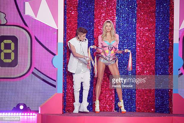 Justin Bieber checks out VS Model Jessica Hart as she walks the runway during the 2012 Victoria's Secret Fashion Show at the Lexington Avenue Armory...