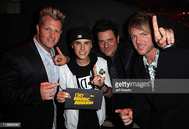 Justin Bieber, Gary LeVox, Jay DeMarcus and Joe Don Rooney of the Rascal Flatts attend the 2011 CMT Music Awards at the Bridgestone Arena on June 8,...