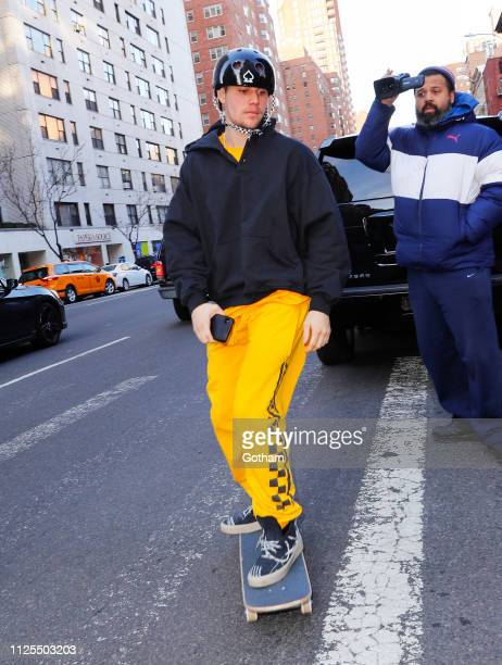 Justin Bieber goes skateboarding wearing checkered taxicabcolored sweatpants on February 17 2019 in New York City