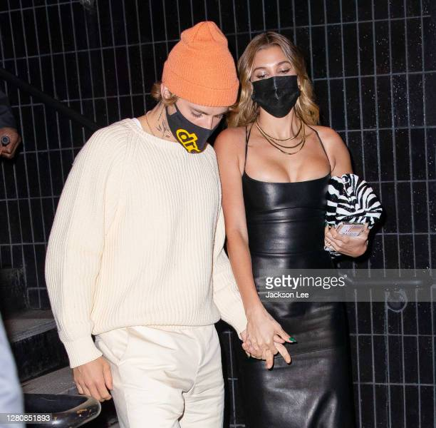 Justin Bieber hold hands with Hailey Bieber when departing SNL afterparty at Catch Steak on October 17, 2020 in New York City.