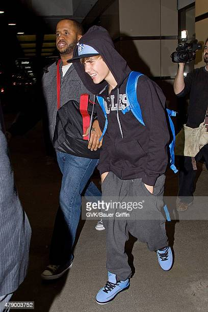 Justin Bieber is seen at Los Angeles International Airport on January 26 2011 in Los Angeles California
