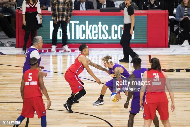 Justin Bieber of Team Lakers in action against Andre De Grasse of Team Clippers during the 2018 NBA AllStar Celebrity Game as part of AllStar Weekend...