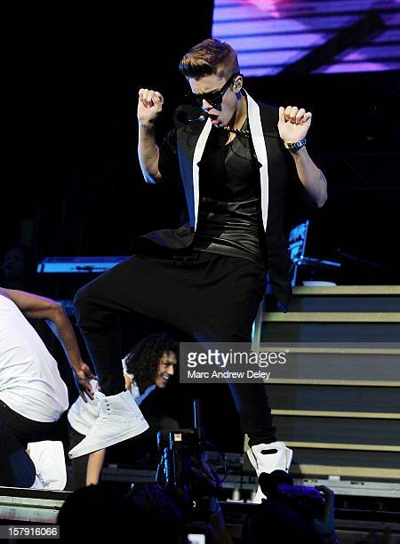 Justin Bieber performs during the KISS 108 Jingle Ball 2012 at TD Garden on December 6 2012 in Boston Massachusetts