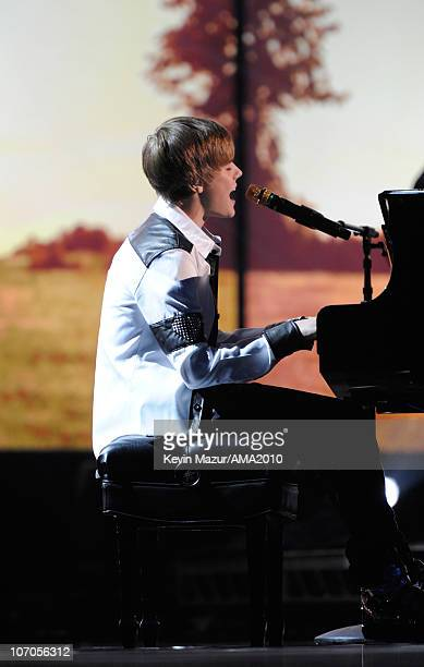 Justin Bieber performs on stage at the 2010 American Music Awards held at Nokia Theatre LA Live on November 21 2010 in Los Angeles California