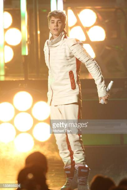 Justin Bieber performs onstage at the 2011 American Music Awards held at Nokia Theatre LA Live on November 20 2011 in Los Angeles California