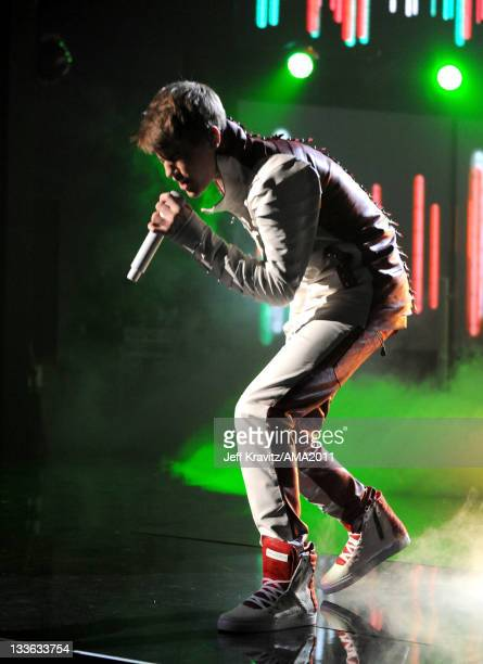 Justin Bieber performs onstage at the Nokia Theatre LA LIVE on November 20 2011 in Los Angeles California