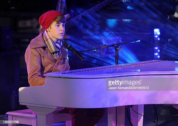 Justin Bieber performs onstage during Dick Clark's New Year's Rockin' Eve with Ryan Seacrest 2012 at Times Square on December 31, 2011 in New York...