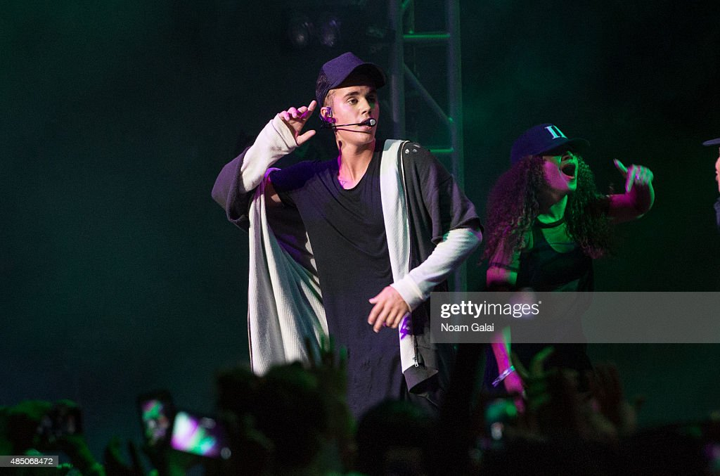 Justin Bieber performs onstage during the 2015 Billboard Hot 100 Music Festival day 2 at Nikon at Jones Beach Theater on August 23, 2015 in Wantagh, New York.