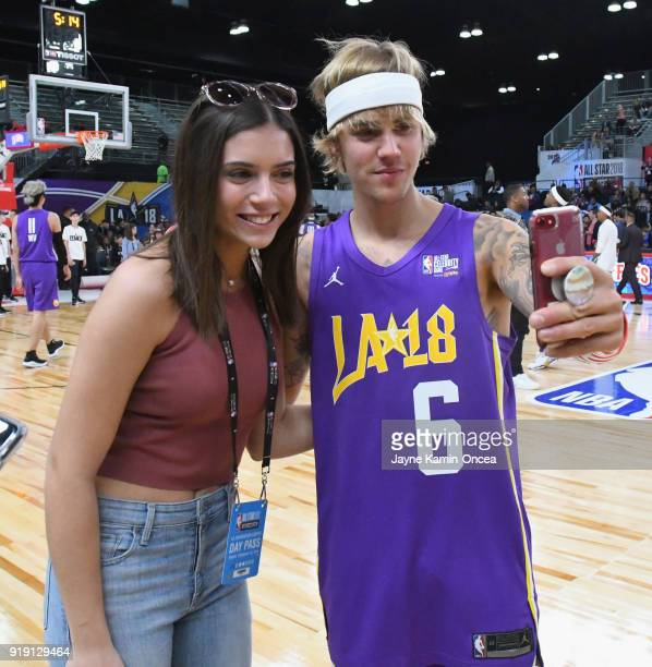 Justin Bieber poses for a photo with a fan during the 2018 NBA AllStar Game Celebrity Game at Los Angeles Convention Center on February 16 2018 in...