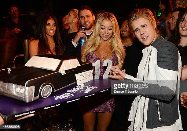Justin Bieber poses with a birthday cake as he celebrates his 21st birthday at OMNIA Nightclub Las Vegas in Caesars Palace on March 14 2015 in Las...