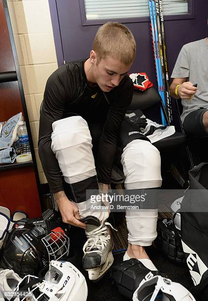 Justin Bieber puts on his skates in the locker room prior to the 2017 NHL AllStar Celebrity Shootout at Staples Center on January 28 2017 in Los...