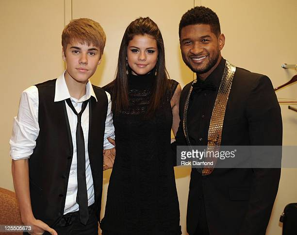 COVERAGE**** Justin Bieber Selena Gomez and Usher Raymond backstage at the 33rd Annual Georgia Music Hall Of Fame Awards at the Cobb Energy...