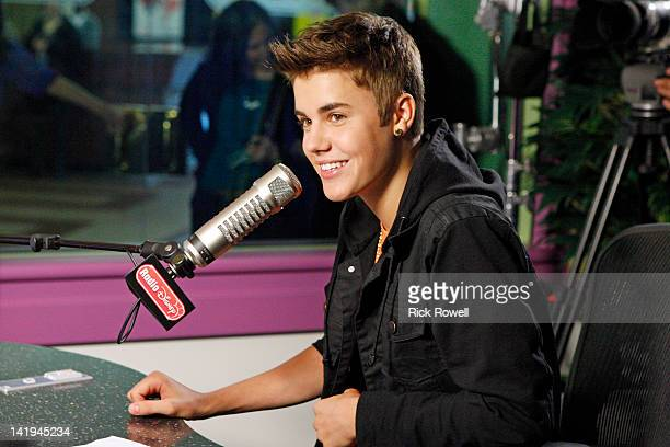 "Justin Bieber stops by Radio Disney to debut his new single ""Boyfriend."" While in studio, he joins Candice to co-host the ""Dot Com Top 3"" and records..."